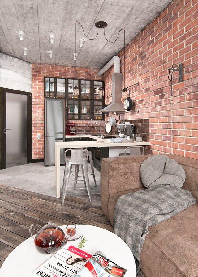 Bỏ qua bức tường ngăn cách, phòng khách và bếp ăn được thiết kế mở tạo không gian thoáng rộng. Tuy nằm trong cùng một không gian nhưng 2 khu vực lại được phân biệt bởi sàn nhà. Toàn bộ sàn nhà khu vực nấu ăn không được ốp gỗ mà thay vào đó là lát gạch vừa bảo đảm sạch sẽ dễ lau chui, vừa có chức năng phân chia không gian.
