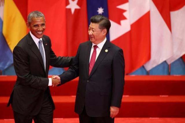 Tổng thống Obama (trái) bắt tay Chủ tịch Trung Quốc Tập Cận Bình tại Hằng Châu. Ảnh: Reuters