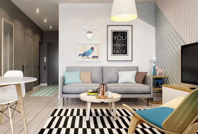 Ngay lối vào nhà là phòng khách được bố trí đơn giản với ghế sofa dài cùng chiếc bàn trà nhỏ có chân tạo không gian rộng thoáng.
