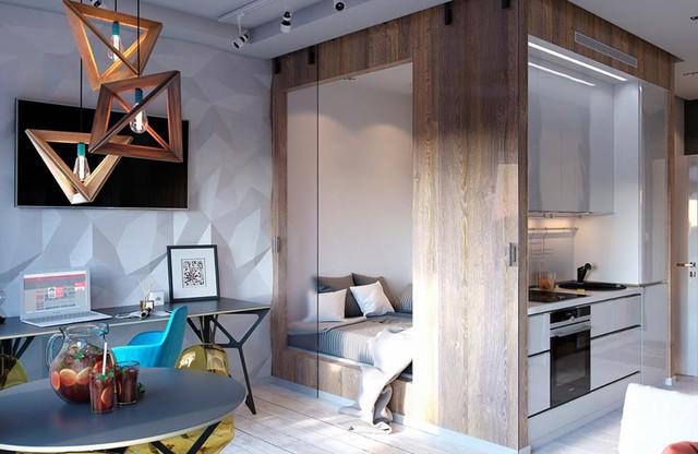 Vì diện tích chật nên tất cả các khu vực chức năng trong căn hộ điều được thiết kế mở khiến không gian trở nên rộng và thoáng hơn so với diện tích thật. Ngay cạnh bàn làm việc là chiếc giường tích hợp bếp ăn vô cùng độc đáo.