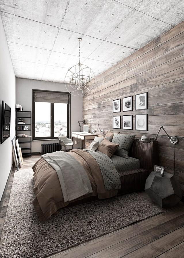 Toàn bộ nội thất bên trong phòng ngủ đều cùng một tông màu nâu chủ đạo từ chăn, ga, gối đến tấm trải sàn, nền nhà, tường. Không gian nghỉ ngơi còn được nhấn nhá với những bức trang nghệ thuật thú vị.