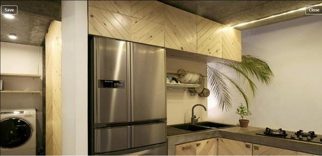 Những vật dụng hàng ngày như tủ lạnh và máy giặt cũng được tính toán và bố trí rất hợp tí vừa không tốn nhiều diện tích vừa bảo đảm thẩm mỹ cho gian bếp.