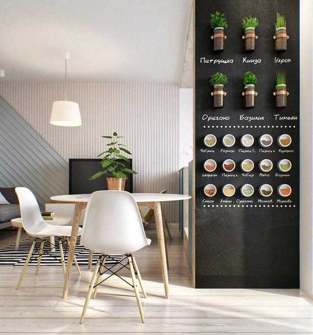 Bức tường màu đen tương phản cùng những họa tiết bắt mắt tạo cho khu vực bếp ăn một không gian vô cùng thú vị.