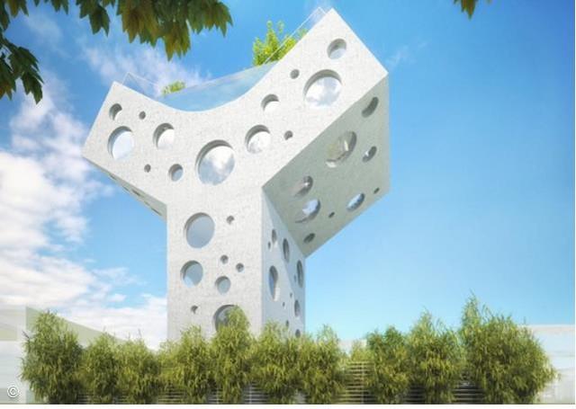 Thiết kế hình chữ Y với những ô cửa sổ hình tròn lạ mắt là điểm nhấn đặc biệt nhất của ngôi nhà.
