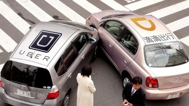 Uber buộc phải bán bộ phận kinh doanh ở Trung Quốc cho Didi. Ảnh: FT