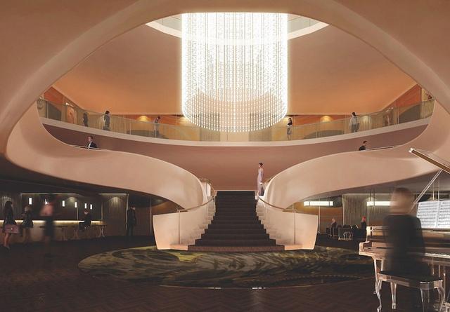 Sảnh lớn được thiết kế rộng rãi, có cầu thang hình vòng cung, đàn piano cỡ lớn và đèn chùm mang phong cách cổ điển. Ảnh: JustLuxe.