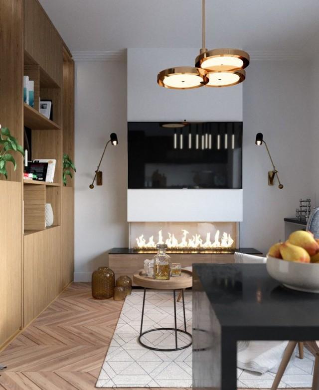 Chiếc tivi lớn nơi phòng khách được gắn cố định vào tường nhằm tiết kiệm diện tích cho căn hộ.
