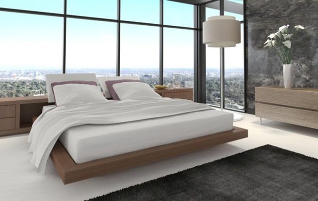 Với những căn hộ ở trên cao, một chiếc giường nổi với chăn, ga, gối tông màu trắng mang đến cho bạn cảm giác bồng bềnh như trên mây.
