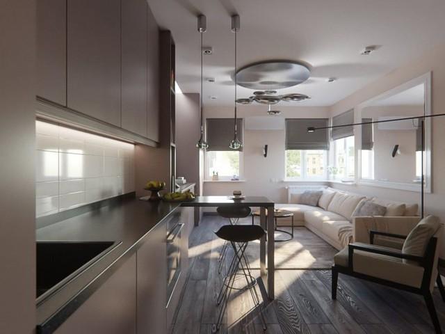 Góc nấu ăn gọn gàng và không hề chiếm nhiều diện tích nhờ được khéo léo bố trí dọc tường nhà. Cùng với nó là hệ thống tủ kệ hoàn toàn khép kín tiện dụng.