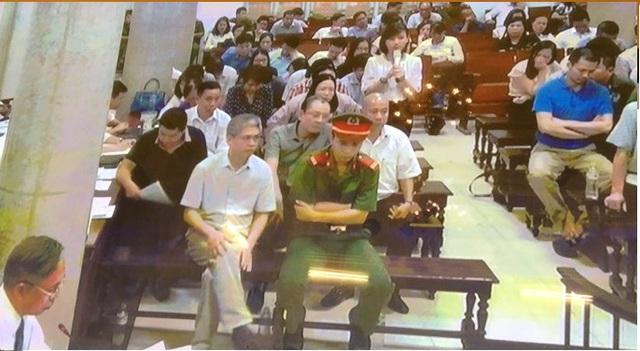 Phiên tòa chiều 7/9: Năm 2011, NHNN đã xử lý 1 số cá nhân tại DongABank, HDBank... liên quan đến việc chi vượt trần - Ảnh 1.