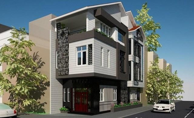 Gam màu tối chủ đạo kết hợp mảng tường trắng xen kẽ giúp ngôi nhà 3 tầng nổi bật so với các công trình xung quanh. Ảnh: Banvenhadep.