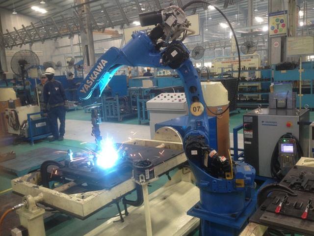 Một công đoạn sản xuất, lắp ráp ô tô trong nước Ảnh: Thùy Dương
