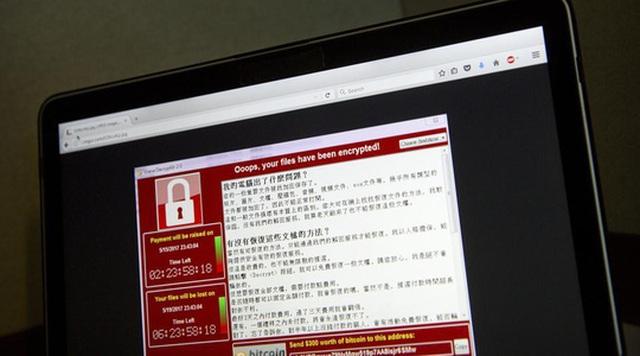 Một máy tính ở Đài Loan cảnh báo bị tấn công bằng mã độc. Ảnh: AP