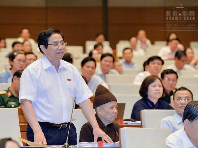 Ủy viên Bộ Chính trị Phạm Minh Chính, đại biểu tỉnh Quảng Ninh, phát biểu tại hội trường. Ảnh: QH