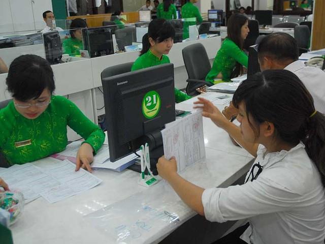 Đến cuối năm 2011, Ngân hàng Vietcombank mới bán thành công đợt 1 với mức 15% cổ phần cho Tập đoàn tài chính Mizuho của Nhật. Ảnh: HTD