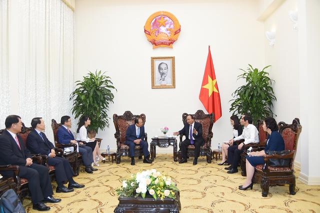 Thủ tướng tiếp lãnh đạo Samsung. Ảnh: VGP/Quang Hiếu