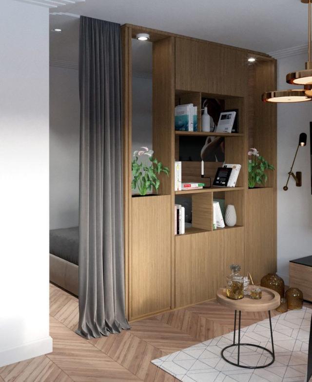 Chỉ với 27m2 nhưng gia chủ của căn hộ này đã khá khéo léo trong việc tách biệt các không gian bằng vách ngăn với hệ kệ gỗ đơn giản, gọn nhẹ.