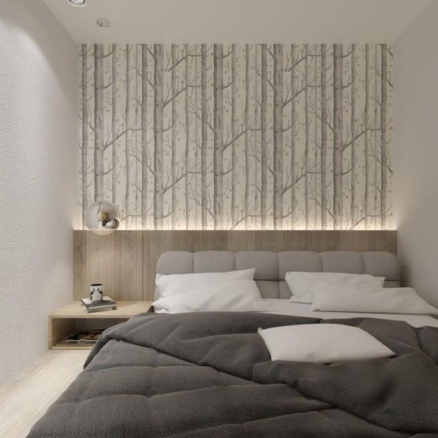 Nơi đầu giường còn được trang trí với giấy dán tường và ánh sáng điện khiến không gian có thêm chiều sâu.