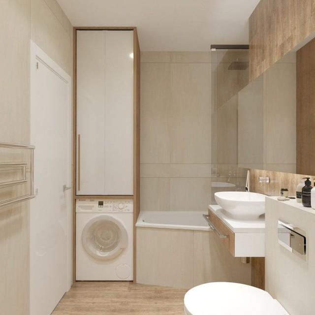 Một chiếc tủ cao sát trần với bên dưới là nơi để máy giặt, bên trên là tủ đựng quần áo và những đồ dùng trong nhà tắm.