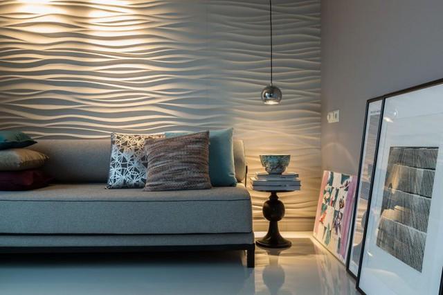 Phòng ngủ yên tĩnh được trang trí bằng bức tường gợn sóng và những bức tranh nghệ thuật.