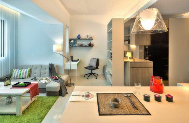 Việc bố trí toàn bộ không gian chức năng liên theo hình vòng cung khiến căn hộ nhỏ trở nên rộng hơn.