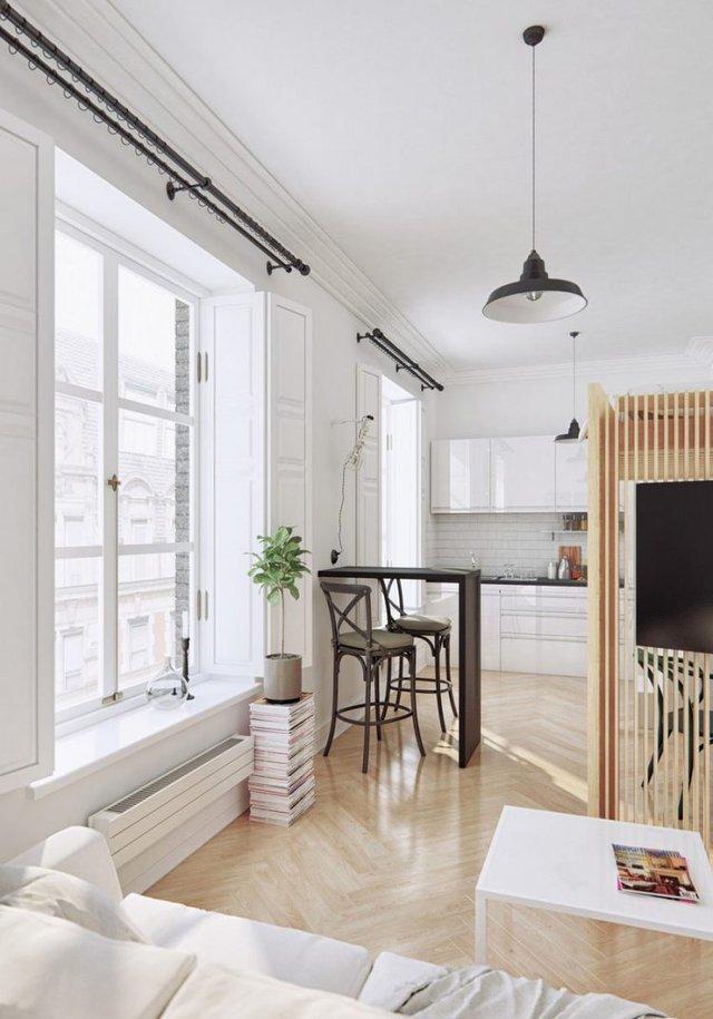 Không gian bên trong được thiết kế hoàn toàn mở với phòng khách, bếp, khu vực nghỉ ngơi, bàn ăn và góc học tập. Phòng khách được bố trí đơn giản nhưng vẫn đẹp cá tính và hiện đại, đối diện bên kia là một góc bếp nhỏ thoáng sáng.