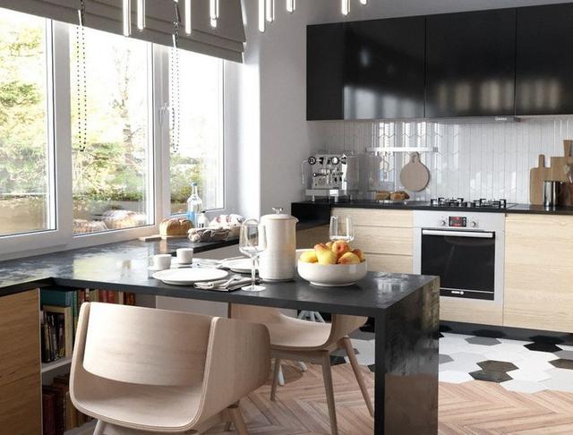 Nhà tuy nhỏ nhưng mọi không gian đều được bố trí ngăn nắp, thoáng sáng và vô cùng sạch sẽ. Bếp và phòng khách được thiết kế mở khiến căn hộ trở nên thoáng rộng hơn.