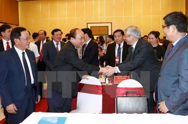 Thủ tướng Nguyễn Xuân Phúc với các đại biểu dự hội nghị. (Ảnh: Doãn Tấn/TTXVN)