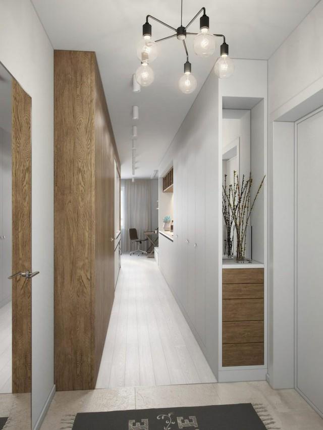 Lối vào nhà là một hành lanh nhỏ thông qua khu vực bếp ăn dẫn sâu vào phòng khách.
