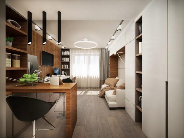"""Khu vực chính gồm nơi tiếp khách, không gian nghỉ ngơi, bàn làm việc được chủ nhân bố trí tại nơi có nhiều ánh sáng nhất cạnh cửa sổ. Việc sử dụng nội thất """"2 trong 1"""" – không gian tiếp khách khi đêm về lại là nơi nghỉ ngơi yên tĩnh giúp tiết kiệm tối đa diện tích cho ngôi nhà."""