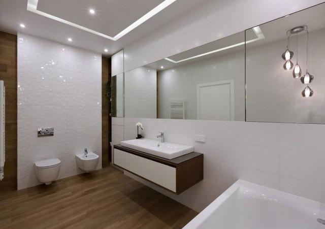 Lấy tông màu trắng chủ đạo, khu nhà tắm càng trở nên rộng thoáng và sạch bóng.