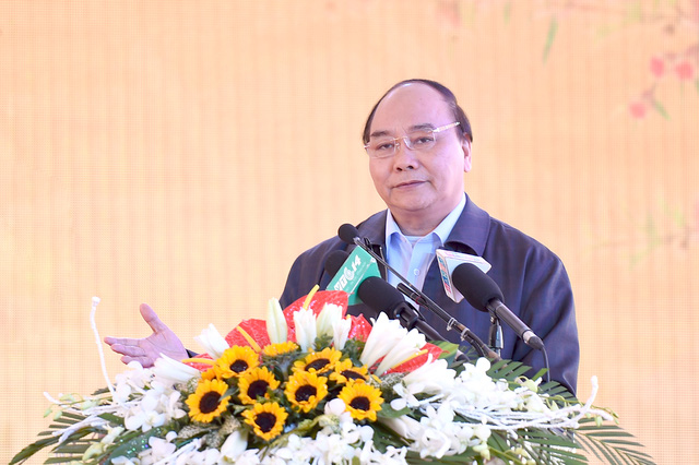 Thủ tướng Nguyễn Xuân Phúc khẳng định: Chính phủ đồng hành với doanh nghiệp, tạo điều kiện cho doanh nghiệp cũng như HTX làm nông nghiệp công nghệ cao. Ảnh: VGP/Quang Hiếu