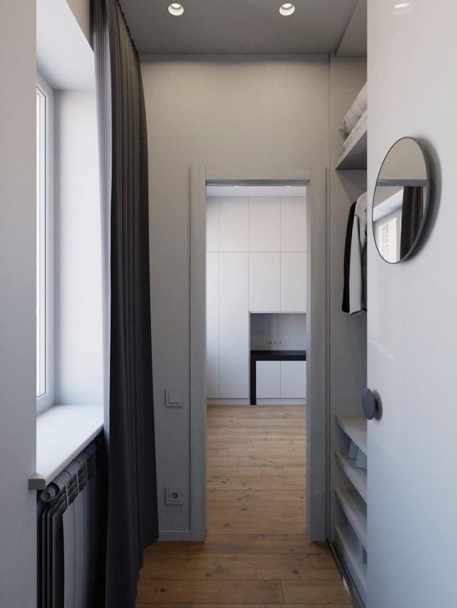 Góc nhỏ này được bố trí hệ thống tủ kệ rất gọn gàng và tiện dụng làm nơi treo quần áo và đồ dùng cá nhân của chủ nhà.
