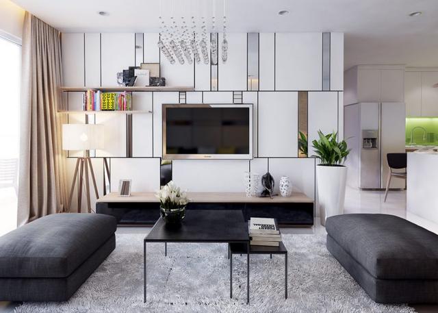 Chiếc tivi được gắn cố định vào tường giúp căn phòng trông rộng rãi hơn hẳn. Đặc biệt gam màu trắng chủ đạo giúp tôn lên vẻ sang trọng, đẳng cấp cho phòng khách, cũng như giúp không gian phòng khách thêm sáng sủa, tràn đầy sức sống.