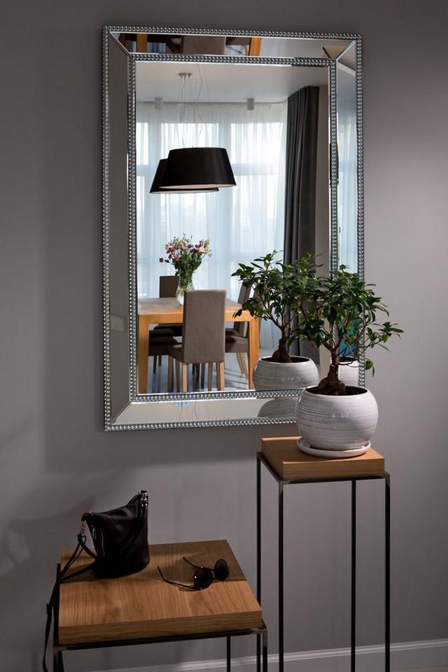 Xuyên suốt các không gian trong căn hộ này là một bảng màu trung tính nhẹ nhàng vô cùng dễ chịu.