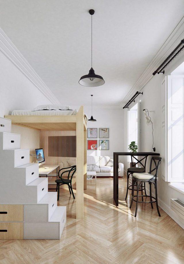 Chỉ với một hệ kệ gỗ đơn giản mà vô cùng thông minh, không gian nghỉ ngơi riêng tư được đưa lên cao nhường lại khoảng không phía dưới cho góc học tập yên tĩnh. Khu vực cầu thang nhỏ lại được tận dụng làm những ngăn kéo trữ đồ vô cùng thuận tiện. Ngay cạnh còn là một bàn ăn nhỏ cho 2 người.