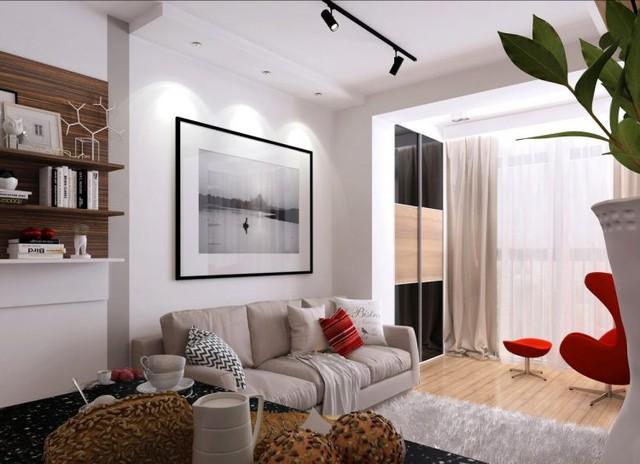 Chiếc ghế sofa dài rộng nơi phòng khách cũng chính là nơi nghỉ ngơi của chủ nhà vào ban đêm.