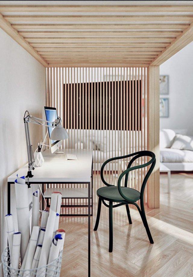 Góc học tập thoáng sáng được thiết kế đơn giản. Hệ lam bằng gỗ bên cạnh vừa là điểm nhấn trang trí cho căn hộ vừa là tấm vách ngăn nhẹ nhàng giữa khu vực phòng khách và góc học tập.