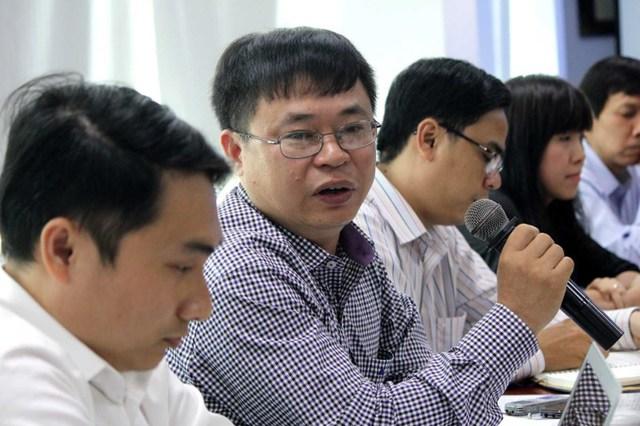 Ông Trần Ngọc Liêm – Phó GĐ Phòng Thương mại và Công nghiệp Việt Nam VCCI thảo luận ở tọa đàm. Ảnh: HOÀNG GIANG