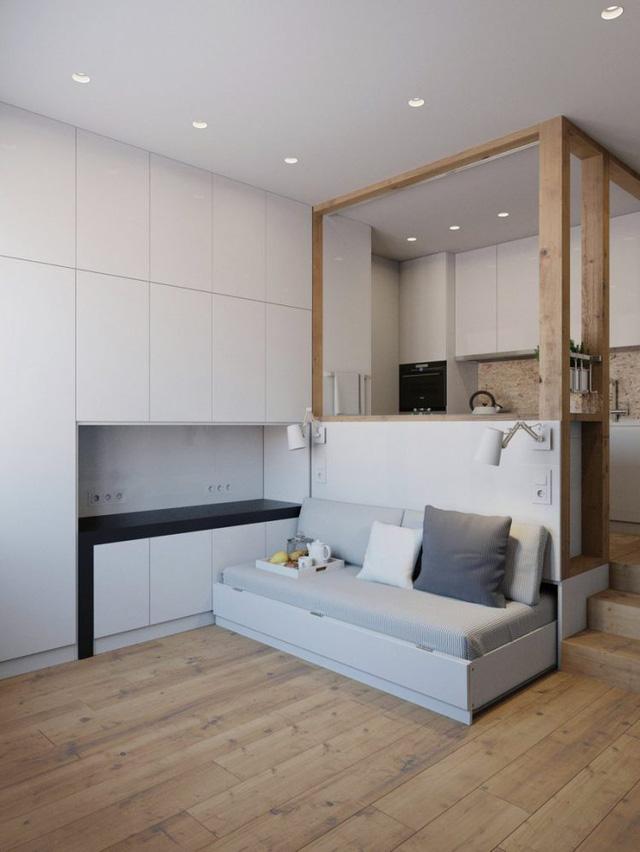 """Góc tiếp khách đơn giản với chiếc """"ghế sofa"""" dài sát tường cùng hai chiếc đèn trang trí lạ mắt."""