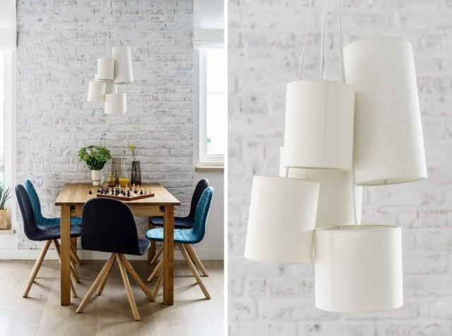 Bàn ăn nhỏ của gia đình 5 thành viên được thiết kế đơn giản cạnh bức tường thô sơn trắng. Bên trên còn có chiếc đèn chùm bằng giấy đẹp và lạ.
