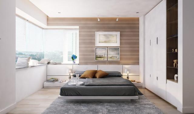 Gam màu trắng chủ đạo thoáng sáng không chỉ hiện diện ở phòng khách, bếp mà còn len lỏi vào các phòng ngủ của căn hộ. Một trong hai phòng ngủ của gia đình được bố trí ngay góc nhà với hai mặt thoáng có view nhìn ra bên ngoài tuyệt đẹp.