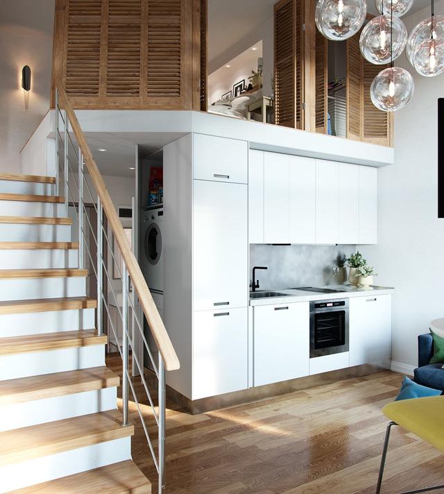 Khu bếp nhỏ xinh nhưng có thể đáp ứng hết những tiện nghi cần thiết cho cả một gia đình. Hệ tủ kệ trắng kết hợp với mặt bàn bằng đá xám tạo nên cái nhìn thoáng sạch và sang trọng. Chiếc máy giặt được đặt ở vị trí khá kín đáo trong một chiếc tủ ở hành lang.