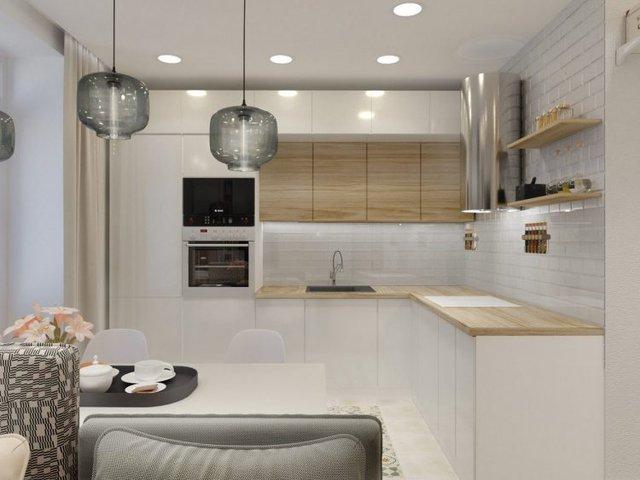 Nơi bếp ăn cũng được trang bị hệ thống kệ kín hình chữ L màu trắng thoáng sáng và sạch sẽ.