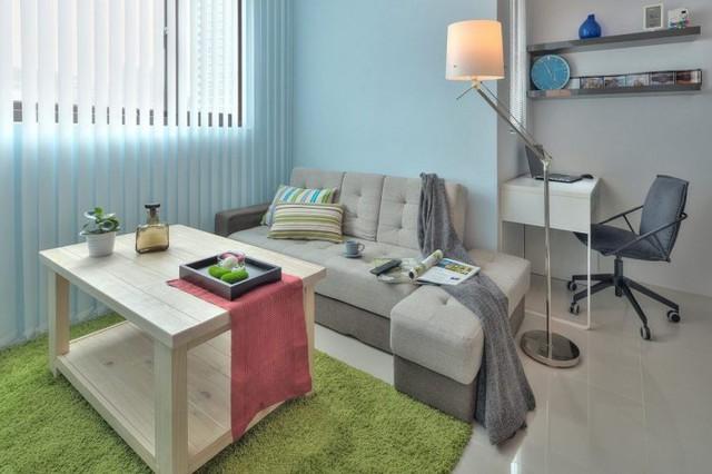 Nơi đây phân biệt với những không gian chức năng khác bằng gam màu xanh không chỉ của tấm thảm mà còn màu của tường nhà.