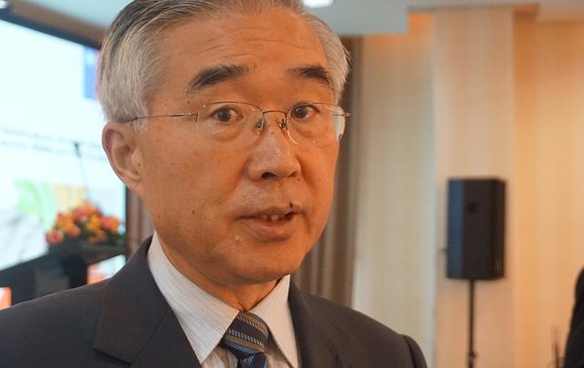 Ông Tang Guoqiang, Đồng chủ tịch Hội đồng Hợp tác Kinh tế châu Á – Thái Bình Dương của đoàn APEC Trung Quốc, trả lời phỏng vấn. Ảnh: Linh Anh