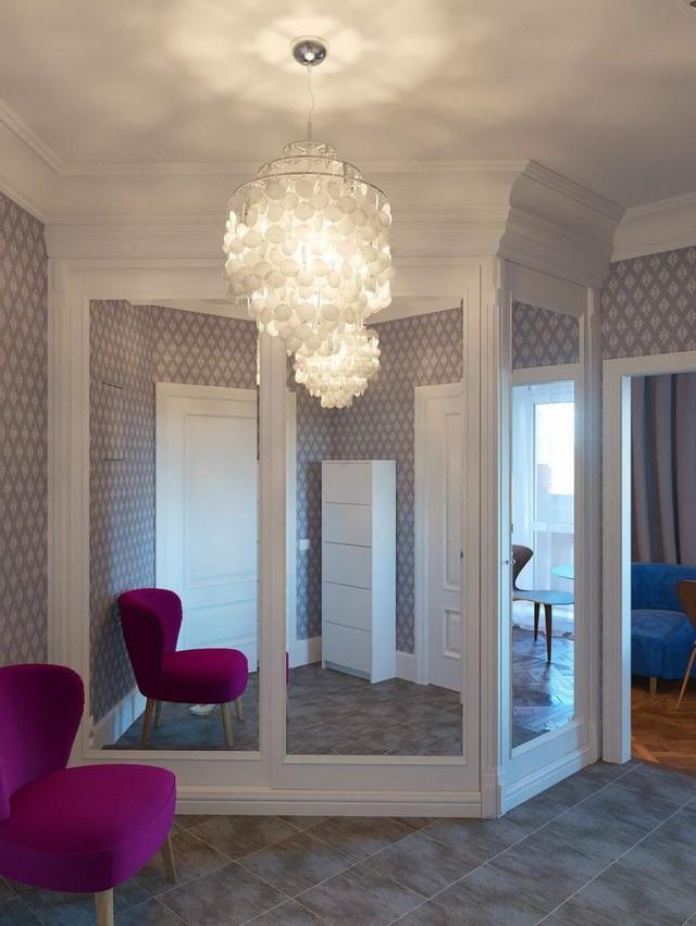 Lối vào nhà được thiết kế vô cùng ấn tượng với chiếc ghế cách điệu màu tím tạo điểm nhấn hút mắt cho lối đi.