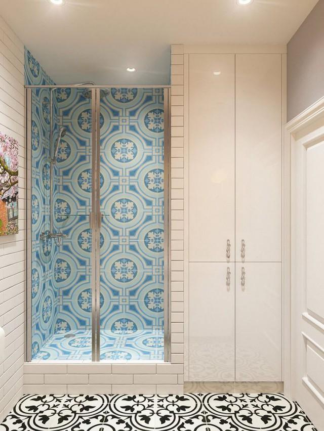 Khu nhà tắm được dành một vị trí riêng biệt với màu gạch ốp tường xanh mát mắt và cửa kính trong suốt.