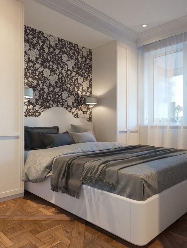 Phòng ngủ được thiết kế gọn gàng với hai bên đầu giường là hệ thống tủ đựng đồ tiện dụng.