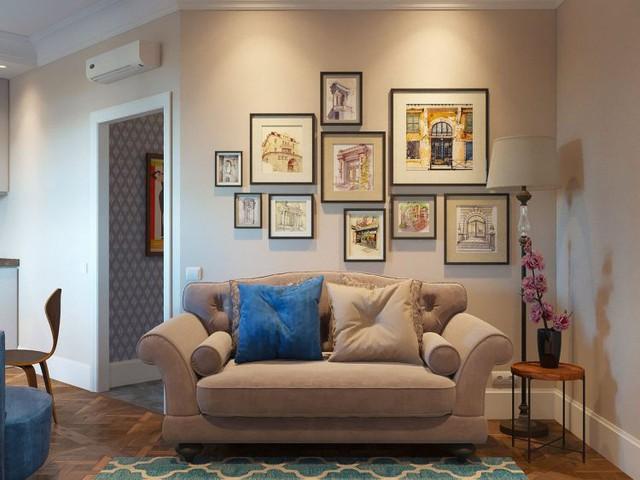 Không gian tiếp khách tuyệt đẹp với chiếc sofa rộng, bên trên còn được tô điểm bằng những bức tranh nghệ thuật treo tường.